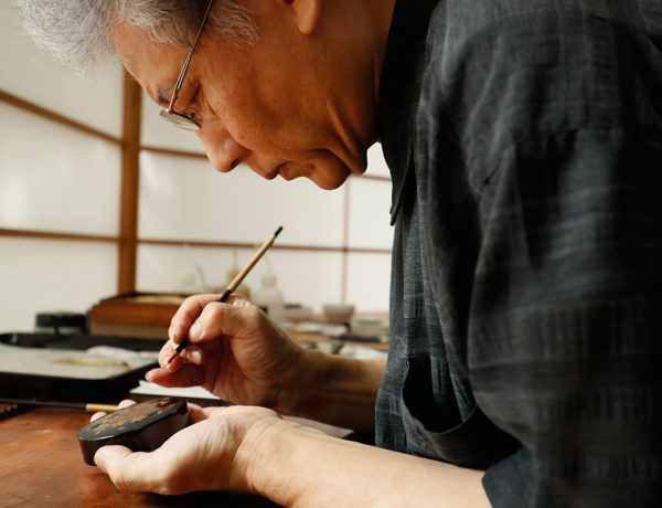TOKYO, JAPAN - AUGUST 23:  Lacquer artist and Japanese living national treasure Kazumi Murose paints on a lacquerware at the Mejiro Institute of Urushi Conservation on August 23, 2016 in Tokyo, Japan. Isetan Mitsukoshi Holdings Ltd. re-opens ISETAN The Japan Store Kuala Lumpur, with most of the items on each shopping floor, will be products made in Japan, in October 2016.  (Photo by Ken Ishii/Getty Images for ISETAN MITSUKOSHI)