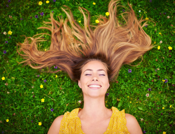 High angle shot of a carefree young woman relaxing in a field of grass and flowershttp://195.154.178.81/DATA/i_collage/pi/shoots/805935.jpg