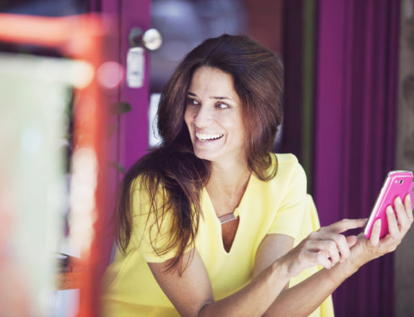 Beautiful Mature Woman Smiling with Cel Phone