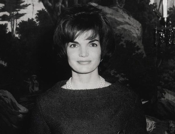 386620 24: First Lady Jacqueline Kennedy poses for a photograph while holding a gift December 12, 1961 at the White House in Washington D.C. (Photo courtesy of Kennedy Library Archives/Newsmakers)