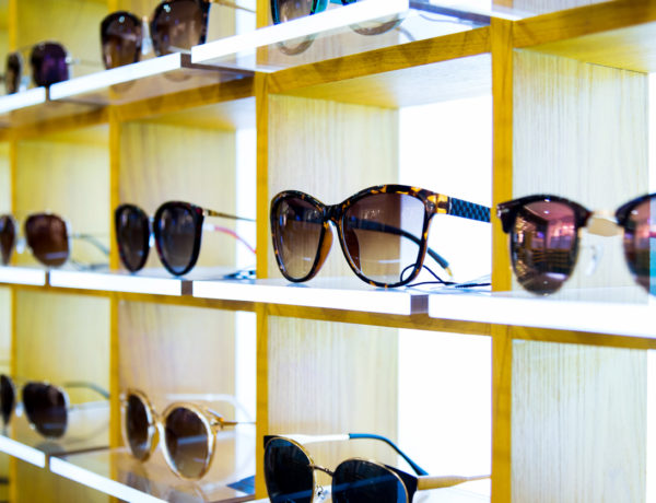 Group of sunglasses in shop.