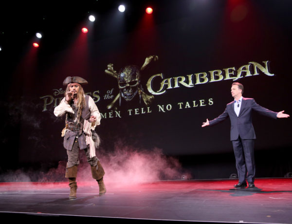 """ANAHEIM, CA - AUGUST 15:  Actor Johnny Depp,  dressed as Captain Jack Sparrow, of PIRATES OF THE CARIBBEAN: DEAD MEN TELL NO TALES (L) and President of Walt Disney Studios Motion Picture Production Sean Bailey took part today in """"Worlds, Galaxies, and Universes: Live Action at The Walt Disney Studios"""" presentation at Disney's D23 EXPO 2015 in Anaheim, Calif.  (Photo by Jesse Grant/Getty Images for Disney)"""
