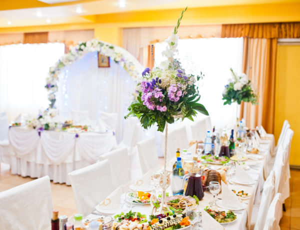 Violet lilac flowers on wedding table